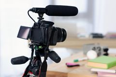 Digital camera with microphone for shooting video blog. At home royalty free stock photo