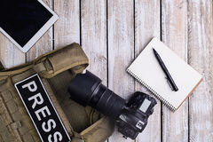 Digital camera,notebook with pen,body armor and tablet touch com Royalty Free Stock Image