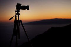 Digital camera over the sunset background Stock Photo