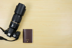 Digital camera and passport on table for travel Stock Photography
