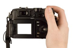 Digital Camera photo in a hand. Isolated on withe background. lcd screen and background can be easily edited Stock Image