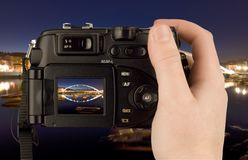Digital Camera photo in a hand. Isolated on withe background. lcd screen and background can be easily edited Royalty Free Stock Photography