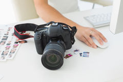 Digital camera on photographers desk Stock Images