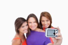 Digital camera photographing three teenagers Stock Photography