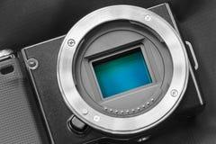 Digital camera sensor/APS-C CMOS sensor on a digital mirrorless Stock Images