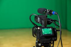 Digital camera in a television Studio. Filming on green screen chroma key.  stock photography