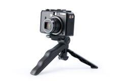 Digital camera on tripod Stock Image