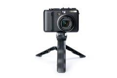 Digital camera on tripod Royalty Free Stock Photo