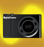 Digital camera vector. Black digital camera vector design on gold light background Royalty Free Stock Photos