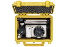 Digital camera in wateroof case. FORT COLLINS, CO, USA, April 25, 2015: Sony A6000 mirrorless digital camera with a mini tripod and spare battery in a waterproof stock photo