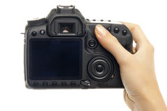 Digital camera in woman hand. Royalty Free Stock Images