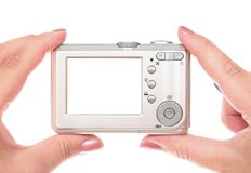 Digital camera on woman hands Stock Image
