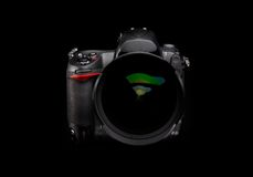 Digital camera with zoom lens. Professional digital camera with zoom lens on black background stock image