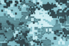 Digital camouflage fabric. Blue digital camouflage fabric texture background or backdrop Royalty Free Stock Photo