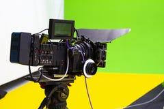 Digital cinema camera in a green visual effects studio. Digital cinema camera set up to take a shot in a specialist green screen visual effects studio royalty free stock images