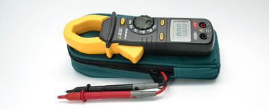 Digital clamp meter with probes. On white background stock photo