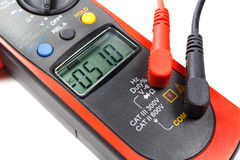 Digital clamp multimeter with probes on a white background Stock Image