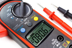 Digital clamp multimeter with probes on a white background Stock Images