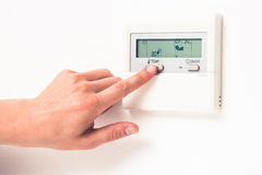 Digital climate thermostat Stock Photo
