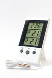 Digital clock and a digital thermometer for measuring temperature Stock Photos