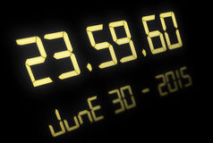 Digital clock with 60 seconds at midnight Stock Photos