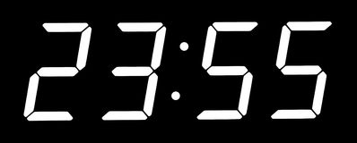 Digital clock show five minutes to twelve Royalty Free Stock Image