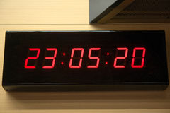 Digital clock on the wall Stock Images