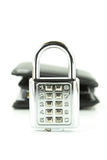 Digital combination lock and background wallet Stock Images