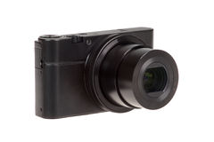 Digital compact camera with open lens isolated Royalty Free Stock Photography