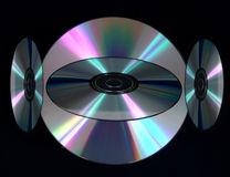 Digital Compact Discs. Compact discs digitaly copied against black background Royalty Free Stock Images