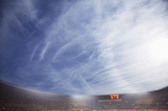 Digital composit of soccer field and blue sky Stock Photography