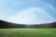 Digital composit of soccer field and blue sky Royalty Free Stock Photography
