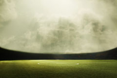 Digital composit of soccer field and cloudy sky Stock Images