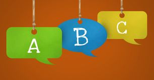 ABC text on hanging paper speech bubbles. Digital composite of ABC text on hanging paper speech bubbles Royalty Free Stock Images