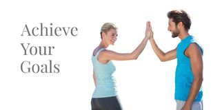 Achieve your goals and fitness couple giving high five. Digital composite of Achieve your goals and fitness couple giving high five stock photo