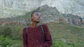 Woman on a mountain side. Digital composite of an African-American woman standing on a mountain side stock video footage