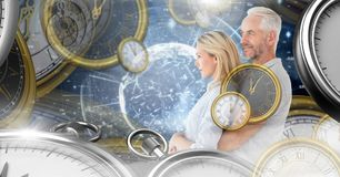 Aging couple in surreal time montage of clocks royalty free stock photography