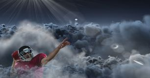 American football player in clouds. Digital composite of american football player in clouds Royalty Free Stock Photos