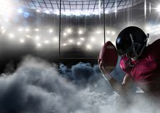 American football player in stadium with smoke. Digital composite of american football player in stadium with smoke Royalty Free Stock Photo