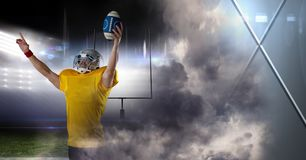 American football player with stadium transition. Digital composite of American football player with stadium transition Stock Images