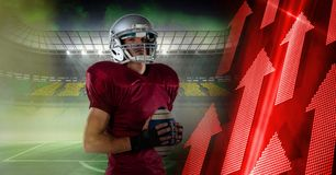 American football player with stadium transition and arrows. Digital composite of American football player with stadium transition and arrows Royalty Free Stock Images