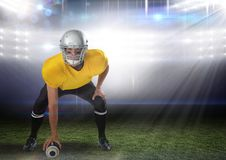 American football  player standing in stadium starting game. Digital composite of american football  player standing in stadium starting game Stock Photos