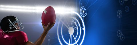 American football player with technology transition. Digital composite of American football player with technology transition Royalty Free Stock Photography