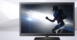 American football player on television. Digital composite of american football player on television Royalty Free Stock Photos