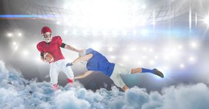 American football players in stadium tackle. Digital composite of american football players in stadium tackle Stock Photos