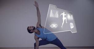 Athletic fit man exercising yoga with health interface. Digital composite of Athletic fit man exercising yoga with health interface Royalty Free Stock Images