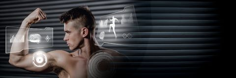 Athletic fit man flexing muscles in gym with health interface. Digital composite of Athletic fit man flexing muscles in gym with health interface stock image