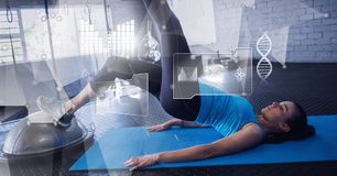 Athletic fit woman in gym with health interface royalty free stock photo