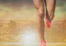 Athletic legs running in bright landscape Royalty Free Stock Photos