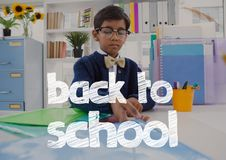 Back to school text against office kid boy holding folders background Stock Photos